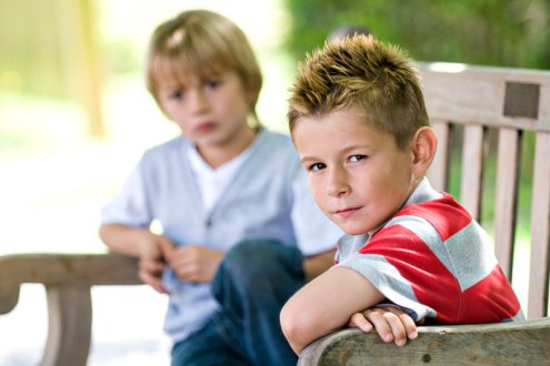 Two kids on a bench